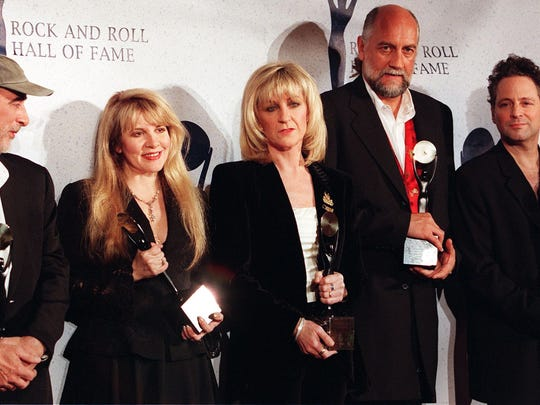 Members of the British rock group Fleetwood Mac, John McVie, Stevie Nicks, Christine McVie, Mick Fleetwood and Lindsay Buckingham appear together after receiving their awards and being inducted into the Rock and Roll Hall of Fame in this January 12, 1998 file photo in New York.  Singer and keyboardist Christine McVie is rejoining Fleetwood Mac after a 16-year absence, as the veteran band plans to hit the road for a major North American tour starting in September.