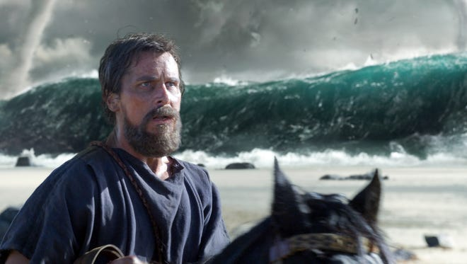 Christian Bale (as Moses) crosses the Red Sea in 'Exodus: Gods and Kings.'
