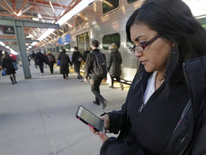 Marilu Rodriguez checks her favorite social media sites on her smartphone on her way home from her Chicago non-profit job; Rodriguez is one of many millennials who follows the news via social networking platforms.