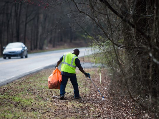 Inmates on the Anderson County Sheriff's Office litter crew work to clean up the trash on the side of Liberty Highway on Wednesday, February 8, 2017 in Anderson.