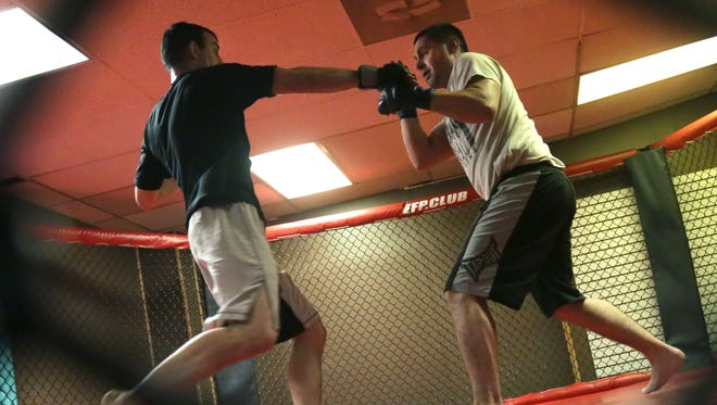 Mitch Whitesel (right) practices with JP Jaranowski in Whitesel's WreckRoom Athletics MMA Gym on Ashland Road in Mansfield.