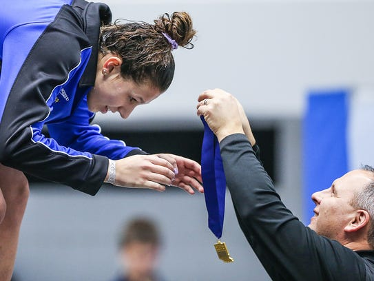 Carmel's Kelly Pash receives her first place medal