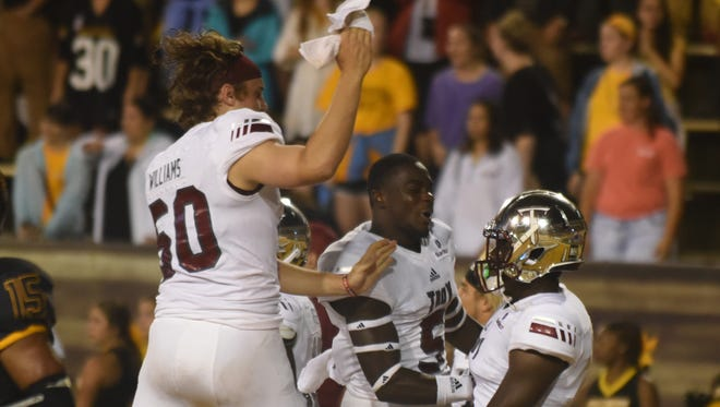 Members of the Troy defense celebrating after beating Southern Miss at M.M. Roberts Stadium on Saturday.