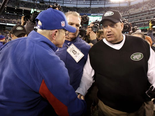 New York Jets head coach Rex Ryan, right, shakes hands with New York Giants head coach Tom Coughlin on Dec. 24, 2011, in East Rutherford, N.J. The Giants won 29-14.
