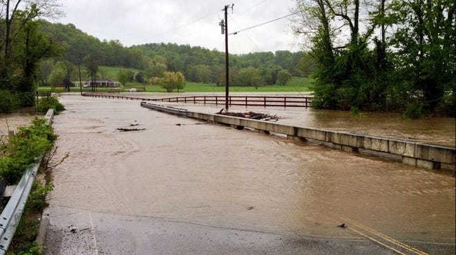 A bridge in Leiper's Fork almost underwater on Monday.