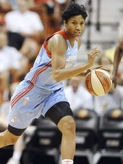 The Atlanta Dream's Angel McCoughtry is trading hoops