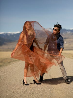 Designer and stylist Jolonzo Goldtooth works with model Caroline Okanee during a shoot in Montana in April.