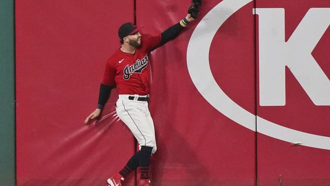 Cleveland Indians' Tyler Naquin can't make the catch on a one-run double hit by Milwaukee Brewers' Keston Hiura in the seventh inning in a baseball game, Friday, Sept. 4, 2020, in Cleveland.