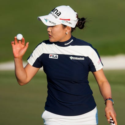 So Yeon Ryu waves to the crowd after making a birdie