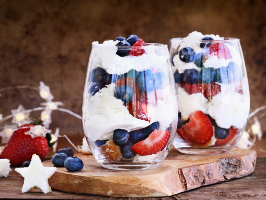 Individual berry trifles with fresh raspberries, strawberries