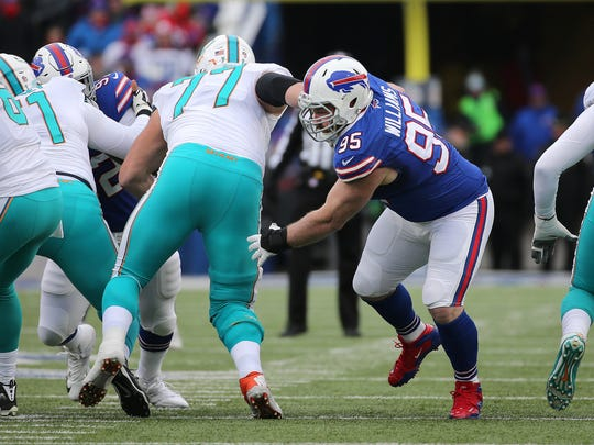 Bills defensive lineman Kyle Williams beats the block of Miami's Jesse Davis (77).