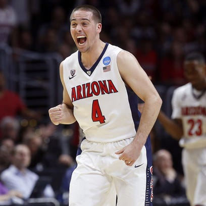 Arizona Wildcats guard T.J. McConnell (4) celebrates