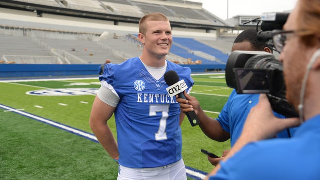 Redshirt freshman QB Drew Barker is interviewed during the University of Kentucky Football media day at Commonwealth Stadium in Lexington, Ky., on August 7, 2015. Photo by Mike Weaver