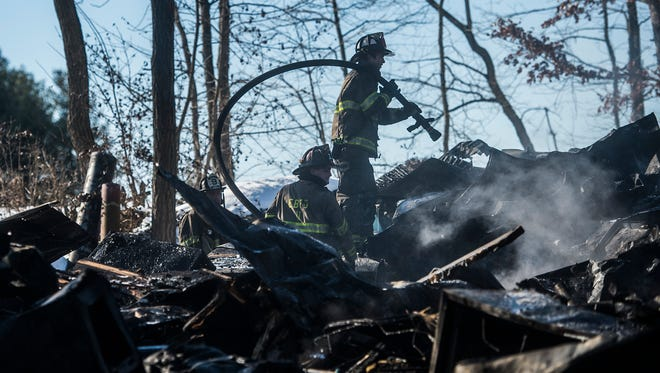 Crews from York Springs and surrounding areas including Hampton, Heidlersburg, Biglerville, East Berlin, Mount Holly, Gettysburg and others work at the scene of a mobile home fire on South Ridge Road in Huntington Township on Jan. 27, 2016. No one was hurt in the fire, said York Springs Deputy Fire Chief Robert Hawk. The home was a loss, said Hawk, and the cause of the fire is undetermined at this time.