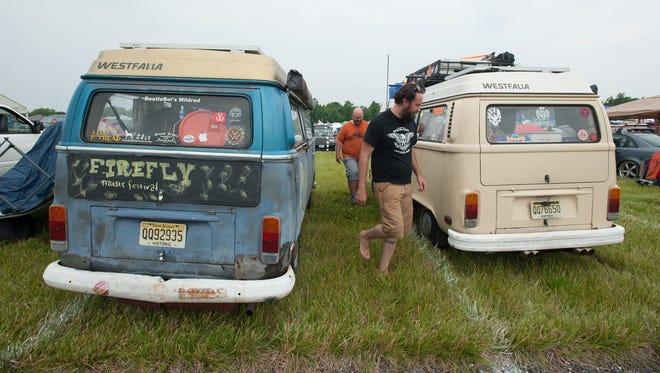 Gregory Schwarz, left of Pennsauken, N.J., and Lord Tyler Marshall of Mount Ephraim, N.J., parking their VW's at their camping spots for the Firefly music festival in Dover.