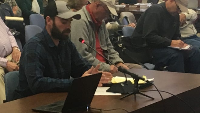 Remi Warren of Reno testifies before the Nevada Wildlife Commission in opposition to widespread transfers of federal land to states.