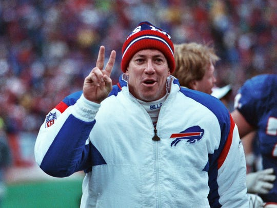 Jim Kelly celebrates a playoff win against the Chiefs in 1994.