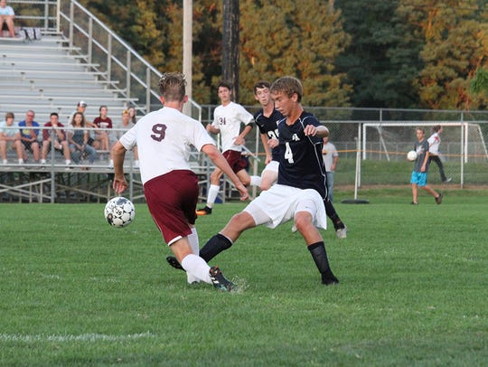 Shippensburg's Chase Diehl (9) looks for a lane around
