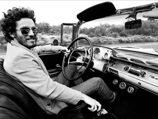 Bruce Springsteen in his 1957 Chevy Bel Air.