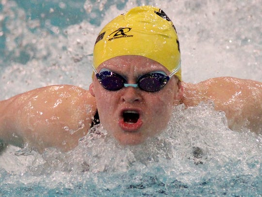 Isabelle Murray of Taylor wins the 100 yard butterfly.