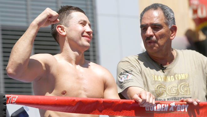 "Boxer Gennady ""GGG"" Golovkin, left, and his coach Abel Sanchez host an open-to-the-public media workout at L.A. LIVE."