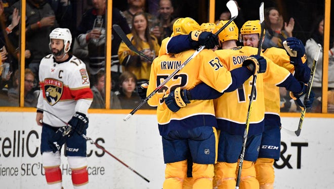 Nashville Predators left wing Kevin Fiala (22) celebrates with teammates after scoring against the Florida Panthers during the second period at Bridgestone Arena in Nashville, Tenn., Saturday, Jan. 20, 2018.