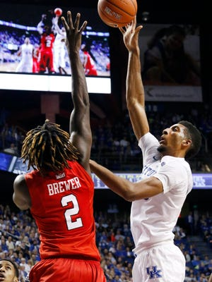 Kentucky's Marcus Lee, right, shoots while defended by Illinois State's Quintin Brewer (2) during the second half of an NCAA college basketball game Monday, Nov. 30, 2015, in Lexington, Ky. Kentucky won 75-63.