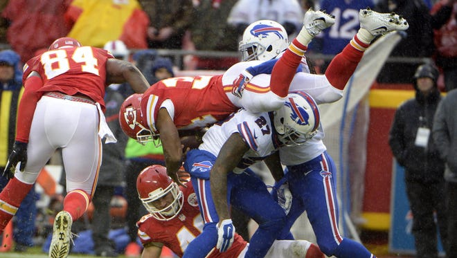 Kansas City Chiefs running back Knile Davis (34) is tackled by Buffalo Bills strong safety Duke Williams (27) in the second half at Arrowhead Stadium.