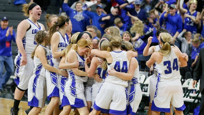 Calumet players  celebate their 57-49 win over Flint Hamady in the MHSAA Class C girls basketball final on Saturday, March 21, 2015 in East Lansing.