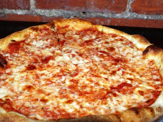 Thin-crust pizza at AJ's Burgers in New Rochelle.