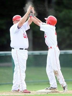 """Former players and coaches used words like """"selfless,"""" """"passionate"""" and """"intense"""" to describe Sean Walsh, here celebrating with Drew Tardif after the player arrived safely at third in a Barnstable Post 206 game in 2014."""