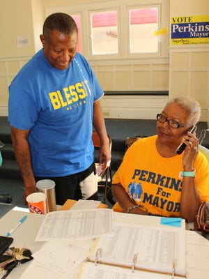 Former Selma Mayor James Perkins confers with staff worker Synethia Holyfield Tuesday afternoon as voting continued for Selma's new mayor.