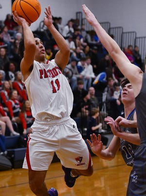 Providence Grove's Questin Overman, shown here in action against Jordan-Matthews last season, scored 18 points in the Patriots' win over Page on Thursday. [Paul Church/Courier-Tribune]