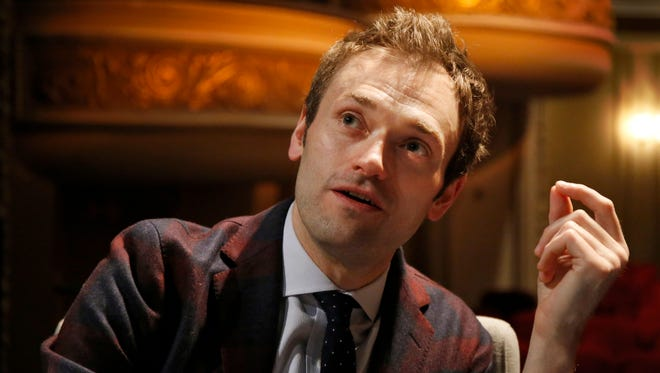 """In this April 5, 2016, file photo, Chris Thile speaks during an interview at the Fitzgerald Theater in St. Paul, Minn. Thile, who replaced Garrison Keillor as host of """"A Prairie Home Companion"""" said the allegations against Keillor came as """"heartbreaking news."""" Thile on Saturday, Dec. 2, 2017, addressed alleged improper conduct by Keillor in the opening minutes of the first show to be broadcast since news of the allegations broke. (AP Photo/Ann Heisenfelt, File)"""