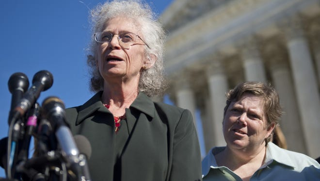 Linda Stephens, an atheist, and Susan Galloway, who is Jewish, speak outside the Supreme Court after oral arguments on the government prayer case in November.