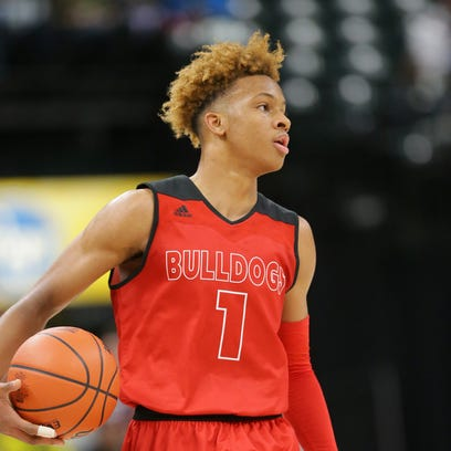 New Albany guard Romeo Langford (1) faces off against