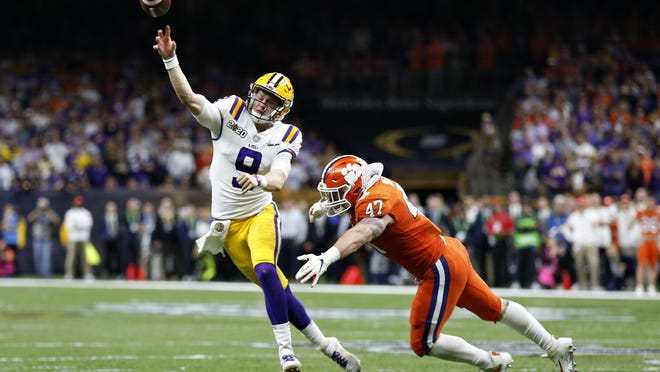 LSU quarterback Joe Burrow passes under pressure from Clemson linebacker James Skalski during the College Football Playoff championship game Monday night in New Orleans.