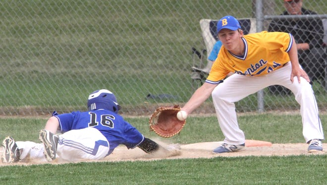 Benton's Brett Benson is ready to catch the ball at first base in a pickoff attempt against Clear Creek Amana. Benton the first game of the doubleheader on May 31. The second game was postponed due to rain.