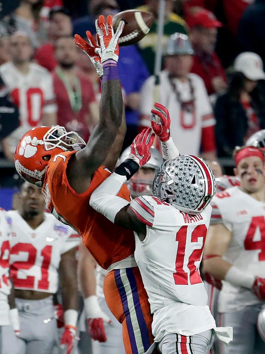FILE - In this Saturday, Dec. 31, 2016, file photo, Clemson wide receiver Mike Williams (7) pulls in a catch as Ohio State cornerback Denzel Ward (12) defends during the first half of the Fiesta Bowl NCAA college football playoff game in Glendale, Ariz. Two of Clemson's most critical pieces last year were not on the field when the Tigers faced Alabama. This time, Mike Williams is back from injury and Deon Cain has kept himself straight after getting sent home during last year's postseason. Both are ready to make an impact against the Crimson Tide on Monday night. (AP Photo/Rick Scuteri, File)