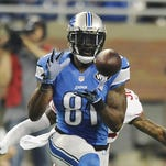 Lions, looking to mend fences, invite Johnson to camp
