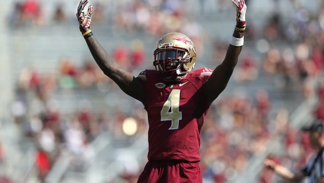FSU's Tarvarus McFadden tries to hype the crowd up against NC State during the Seminoles home opener at Doak Campbell Stadium on Saturday.