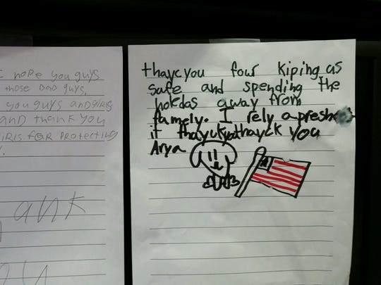 """In addition to meeting the servicemen and women at lunch, kids at the West Allis elementary schools also wrote letters that will be sent to Wisconsin soldiers overseas.  Left: """"Thank you! I hope you guys and girls get those bad guys. And I hope you guys and girls stay safe. And thank you guys and girls for protecting ower country. Thank you."""" Right: """"Thayc you four kiping us safe and spending the holedas away from famely. I rely apreshe it thayck you thayck you"""""""