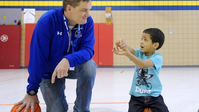 Kurtiss Riggs talks with his mentee Tyshaun Nguyen, 7, at Terry Redlin Elementary School in Sioux Falls, S.D., Friday, Jan. 8, 2016.