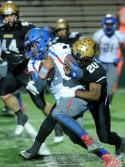 Abilene High's Terrell Franklin makes a tackle during the Eagles' 55-0 area-round win over El Paso Americas Friday, Nov. 18, 2016 at Shotwell Stadium.