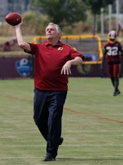 Virginia Gov. Terry McAuliffe tosses a pass during
