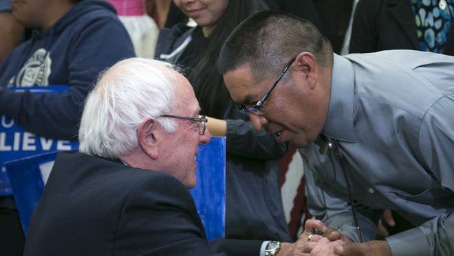 Democratic presidential candidate Bernie Sanders greets a supporter, during a town hall meeting, March 17, 2016, at the Twin Arrows Navajo Casino Resort, 22181 Resort Blvd, Flagstaff, Arizona.