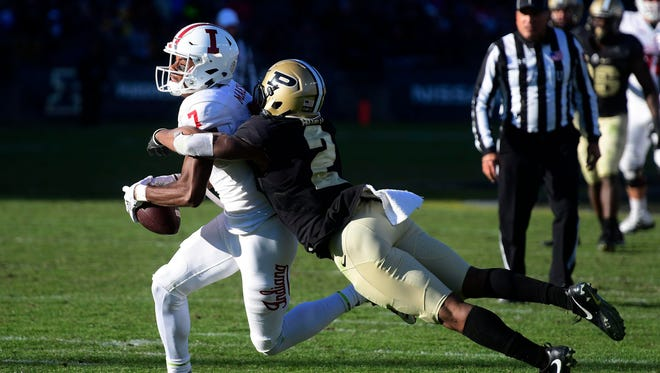 Indiana Hoosiers receiver Taysir Mack (7)  is tackled by Purdue Boilermaker cornerback Da' Wan Hunte (2) in the fourth quarter  at Ross-Ade Stadium.