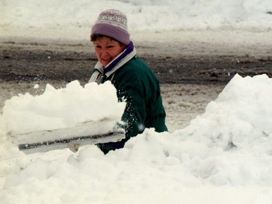 In this Oct. 25, 1997 photo, Sandy Swann heaps snow