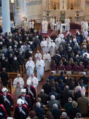 Clergy file out at the end of funeral services for Bishop Emeritus Kenneth Angell at St. Joseph's Co-Cathedral in Burlington on Tuesday, October 11, 2016.