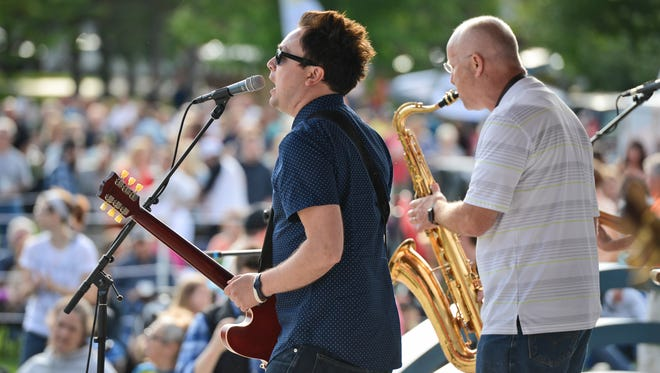 """Justin Ploof of Justin Ploof and the Throwbacks sings """"Runaround Sue"""" as the band plays for the inaugural Summertime by George! event of the season Wednesday night, June 15, in St. Cloud."""